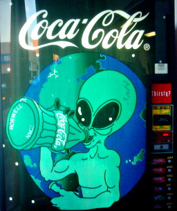 A vending machine in Roswell, New Mexico, showing a space-alien drinking Coca-Cola
