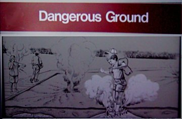 Sign:Dangerous Ground -with illustration of kid falling into ground and getting broiled-