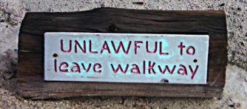 Sign:Unlawful to Leave Walkway